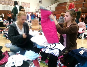 Sorting the clothes into sizes