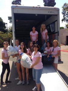 Volunteers unloading truck